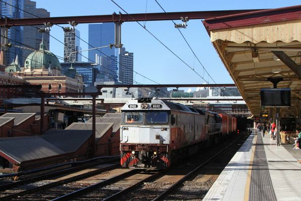 G532 and VL356 lead the up Maryvale freight through Flinders Street Station