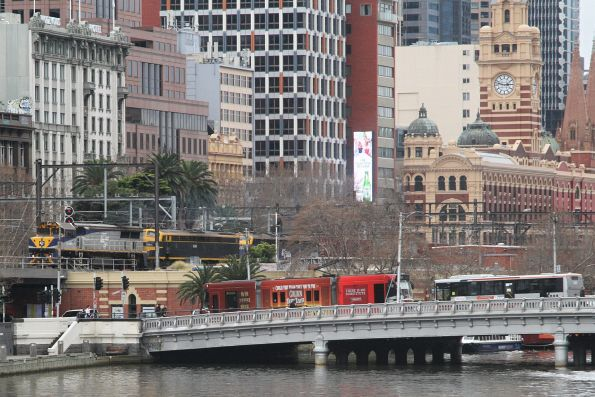 VL360, S303 and B76 cross the Flinders Street Viaduct with the up Maryvale paper train