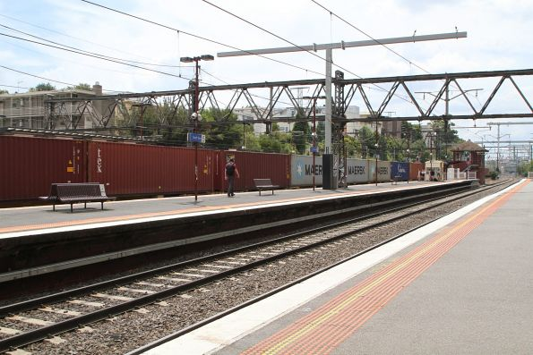 Up Maryvale freight passes through South Yarra platform 3