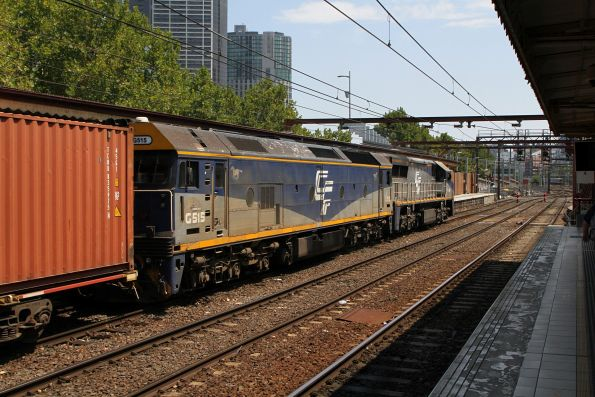 VL356 leads G515 through Flinders Street platform 10 with the up Maryvale freight