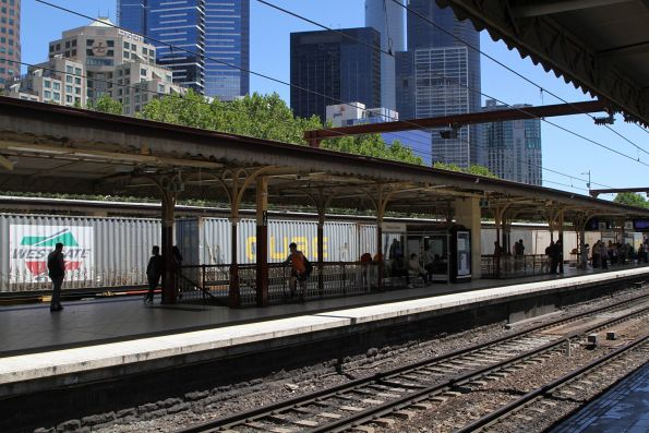 Up Maryvale freight rolls through Flinders Street Station
