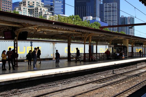 Qube containers on the up Maryvale freight roll through Flinders Street Station