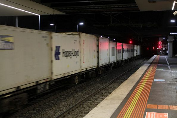 Loaded container wagons in the middle of the down Qube service to Tocumwal