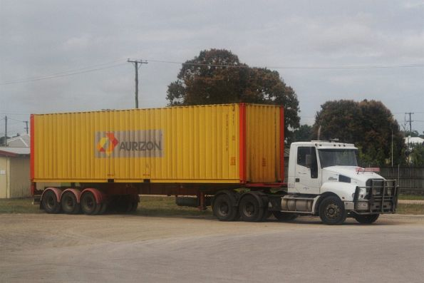 Truck loaded with a 40 foot Aurizon container opposite the railway station at Ingham