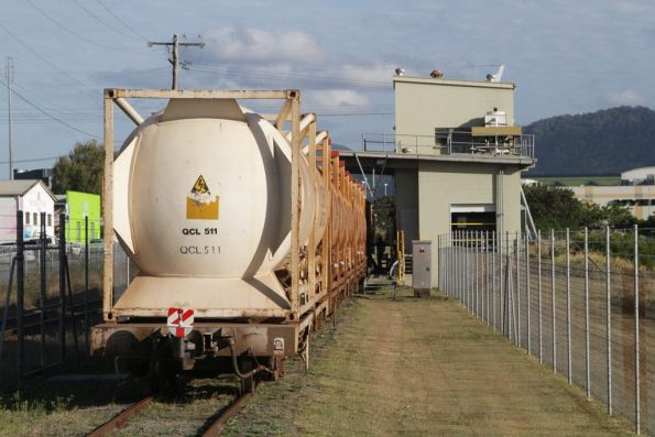 ISO containers carrying cement loaded atop narrow gauge flat wagons