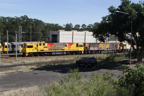 Aurizon 2807 and 4040 lead a consist of random wagons southbound on the Exhibition Loop at Normanby