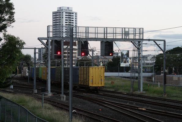 Tail end of an Aurizon freight turns onto the main western line at Roma Street