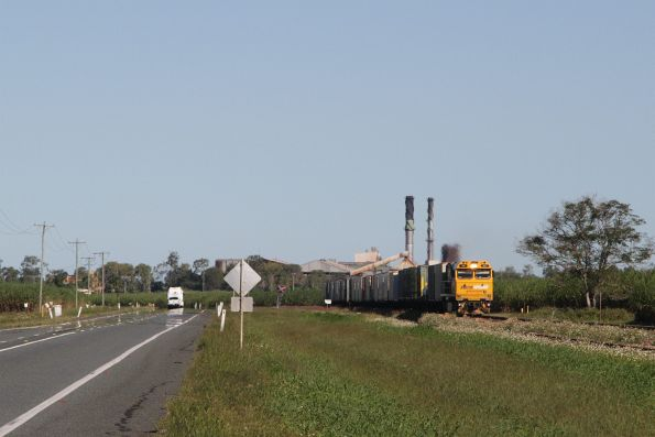 Northbound PN Queensland intermodal service parallels the Bruce Highway out of Proserpine