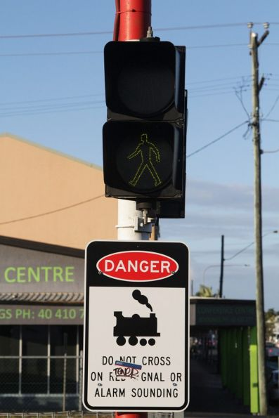 Red and green men feature at a pedestrian level crossing in Cairns
