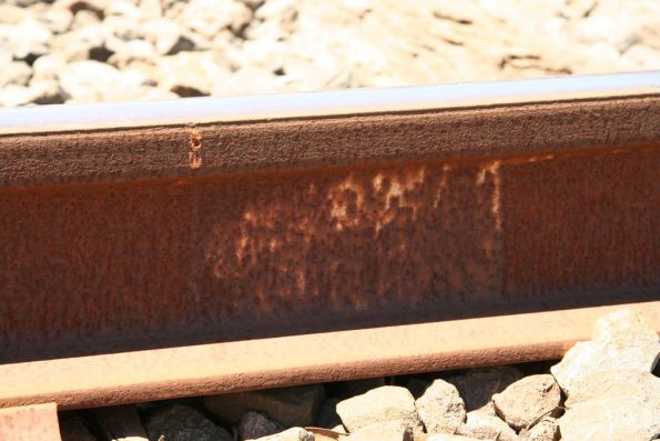Punched hole on the side of the rail, used as the datum for rail creep measurement