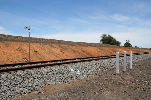 The usual triple post rail creep markers, at the 153 km post of the Warrnambool line