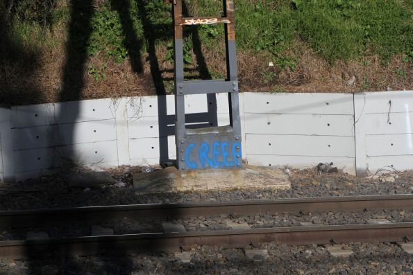 'Creep' spray painted on a stanchion at Toorak