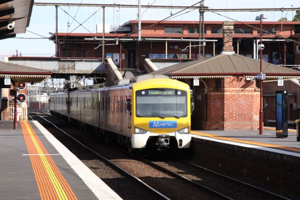 Siemens train with Metro stickers on the up at North Melbourne