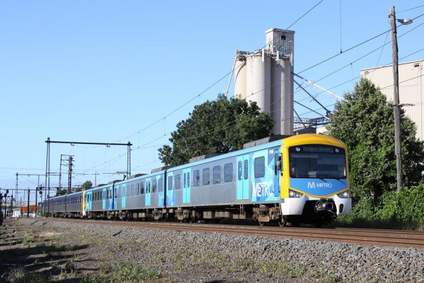 Siemens 775M in Metro livery coupled to a Connex liveried set, on the up at Newport