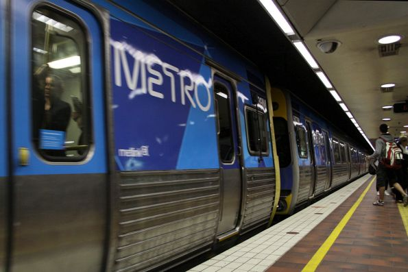 First Metro liveried Comeng, EDI 439M and Alstom 607M at Melbourne Central