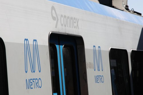 Old Connex decals showing above the doors of a 1st series X'Trapolis