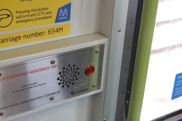 'Connex' branding uncovered on the emergency intercom panel aboard an Alstom Comeng