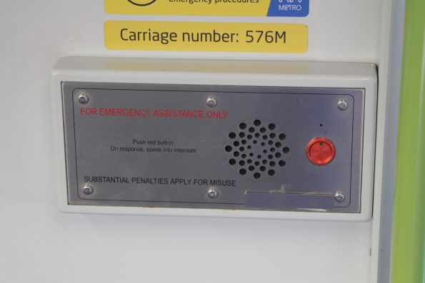 Small metal patch covers the 'Connex' logo on the emergency intercom panel onboard an Alstom Comeng train