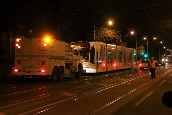 Still pushing the tram along from behind