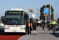 Route 556 passengers board Reservoir Bus Co #32 rego 3148AO outside the new Epping Station