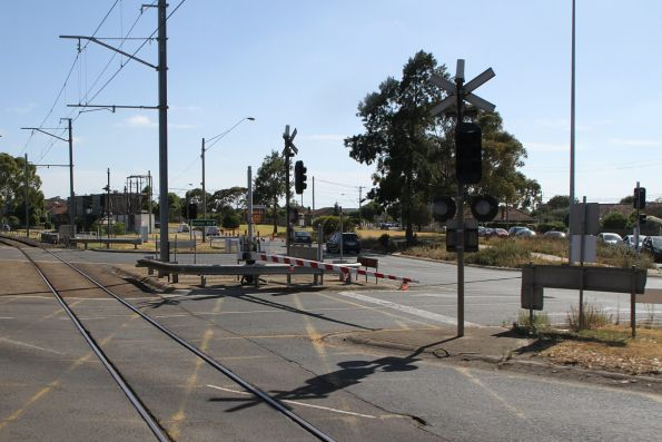 Passing through the mess of roads through the level crossing at Reservoir