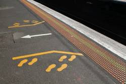 'Wait here / exit there' markings at Richmond platform 8