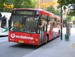Front end of the Vodafone Live promotional bus MO8333 visiting Melbourne from NSW