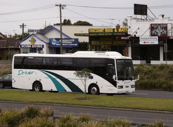 Driver Group coach number 12 rego 1012AO approaches Geelong