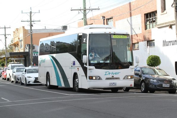 Driver Bus Lines #80 6732AO waiting at the Murrumbeena Road level crossing