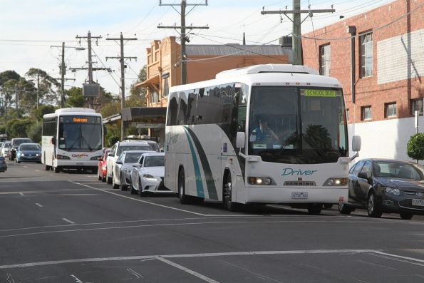 Driver Bus Lines #80 6732AO along with a Quince's coach waiting at the Murrumbeena Road level crossing