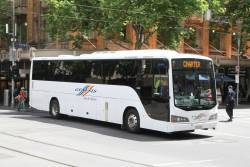 Genesis Tour & Charter bus SB50PA at Collins and Swanston Street