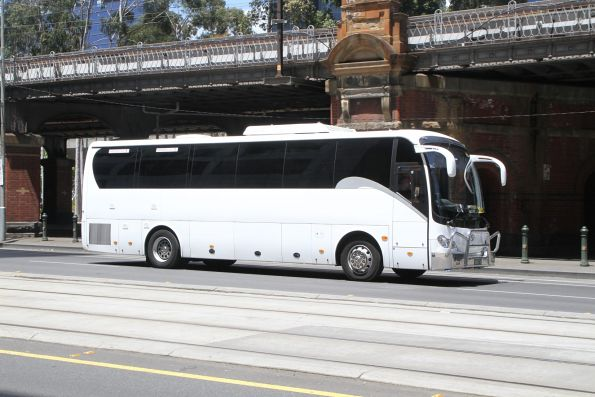 Unidentified road coach BS01YC at Flinders and William Street