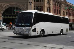 Road coach BS00PM outside Flinders Street Station