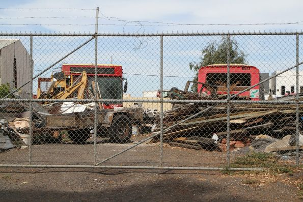 Pair of retired National Bus buses dumped in a yard in Sunshine North