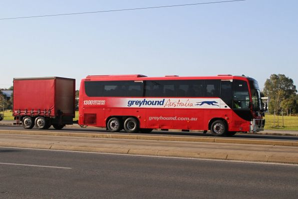 Greyhound Australia road coach #809 with freight trailer heads along Port Road, Adelaide
