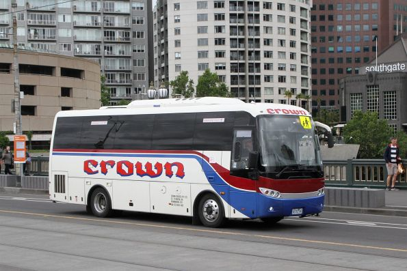 Crown Coaches 4172AO heads north over Princes Bridge