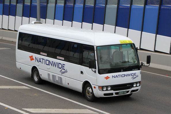 Nationwide Tours minibus #304 BS03WY on Anderson Road, Sunshine
