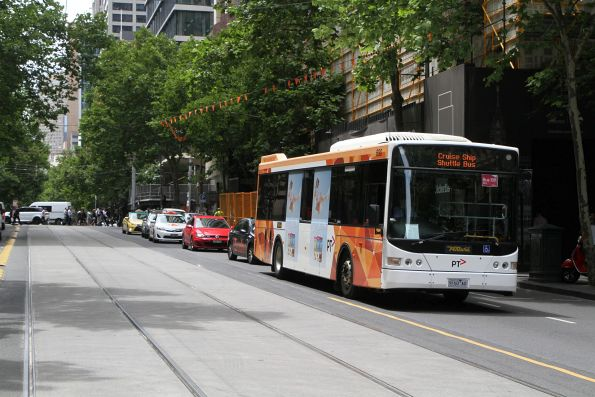 Ventura bus #690 9160AO heads west at Collins and William Street with a route 109 cruise ship shuttle