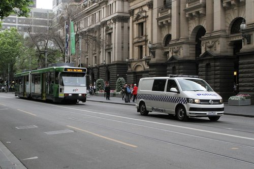Victoria Police lead B2.2020 and B2.2088 on the royal tram transfer to South Melbourne at Swanston and Collins Street