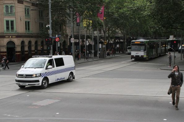 Victoria Police lead B2.2020 and B2.2088 on the royal tram transfer to South Melbourne at Swanston and Flinders Street