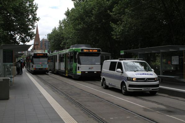 Victoria Police lead B2.2020 and B2.2088 on the royal tram transfer to South Melbourne at the Arts Centre