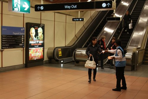 Metro Trains staff member at Flagstaff station, handing out flyers about the upcoming RRL works on the Sunbury line