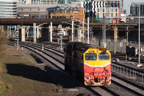 N461 heads towards Southern Cross platform 15 along the new RRL tracks beside North Melbourne station