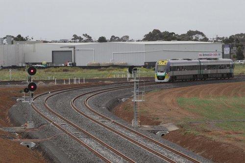 VLocity VL09 headed along the RRL tracks at Deer Park Junction