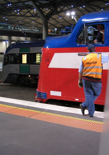 VLocity 23 beside S302 at Southern Cross on the last day of service with V/Line
