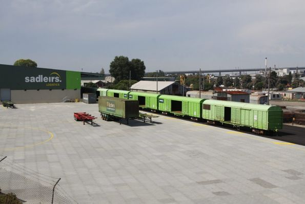 Rake of RLSY louvre vans in the Sadleirs Logistics siding at Spotswood