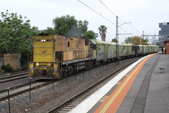 Indian Pacific liveried NR18 long end leading with the down Sadleirs transfer at Middle Footscray