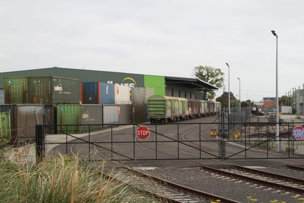 Vans stabled in the Sadleirs Logistics siding at Spotswood