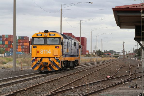 8114 heads through Brooklyn to collect a rake of Sadleirs vans from Spotswood