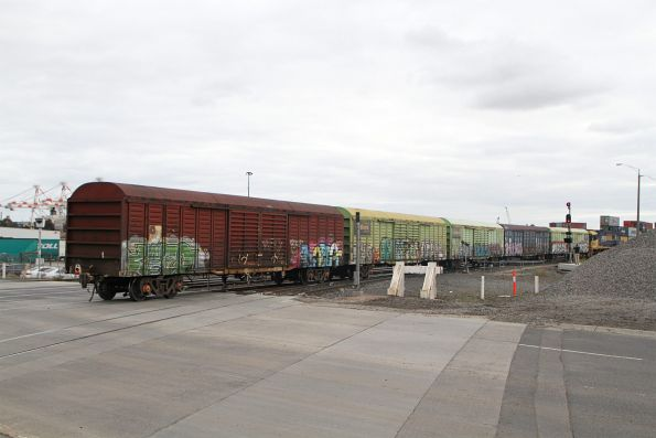 NR60 departs the Melbourne Freight Terminal long end leading on the down Sadleirs shunt